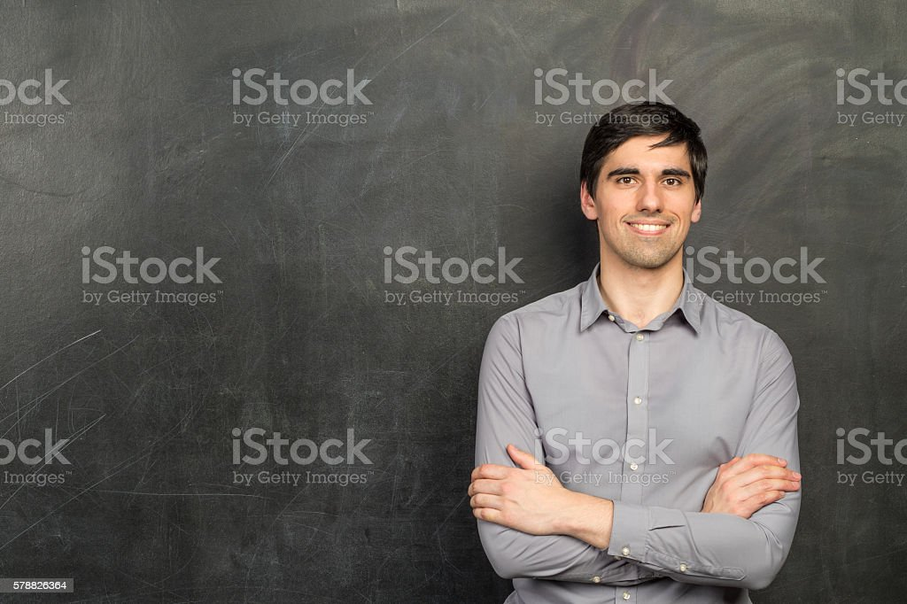 Portrait of young happy smiling teacher man stock photo