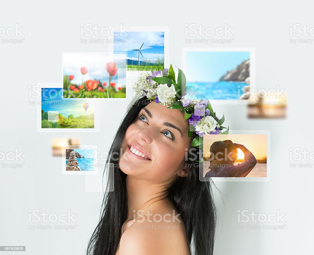Portrait of young happy woman with travel vacation memories stock photo