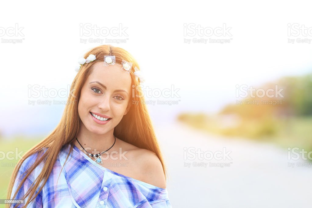 Portrait of young hippie woman on the road stock photo