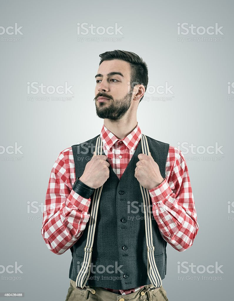 Portrait of young hipster model looking away with raised eyebrow stock photo