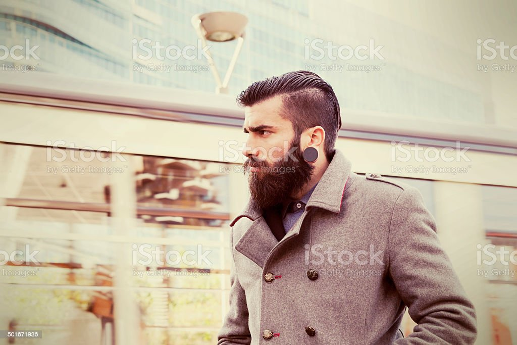 portrait of young hipsters businessman around a modern city stock photo
