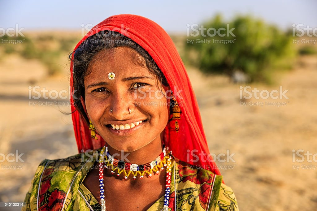 Portrait of young Indian woman, desert village, Rajasthan, India. stock photo