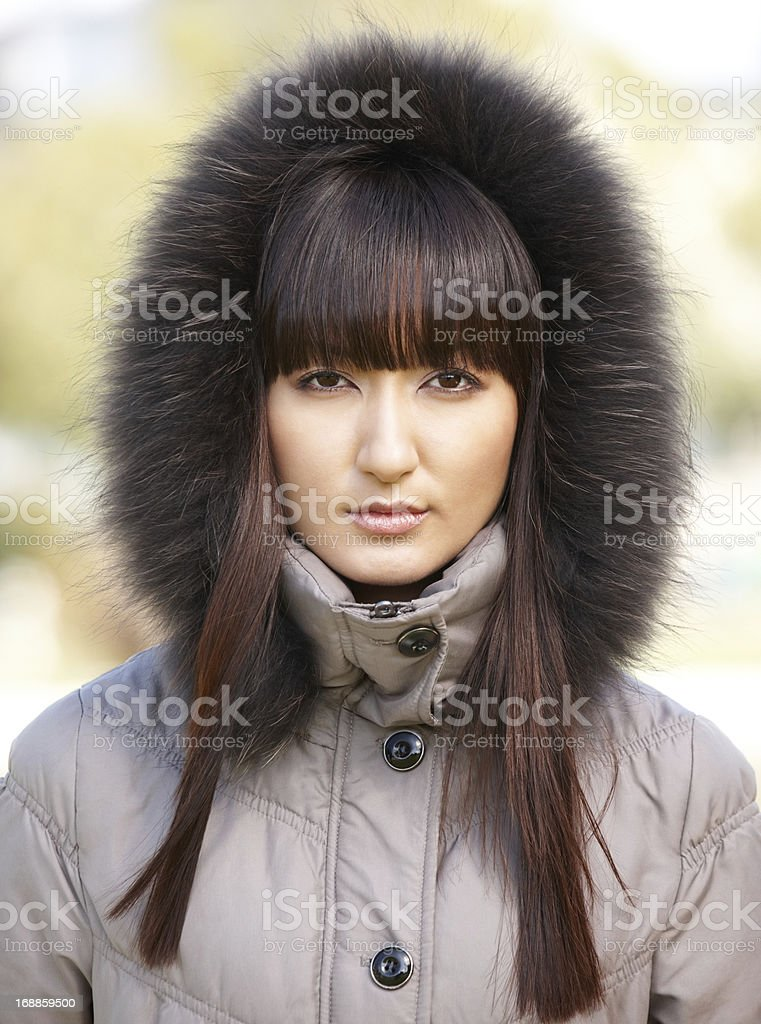 Portrait of young Japanese woman wearing winter coat royalty-free stock photo