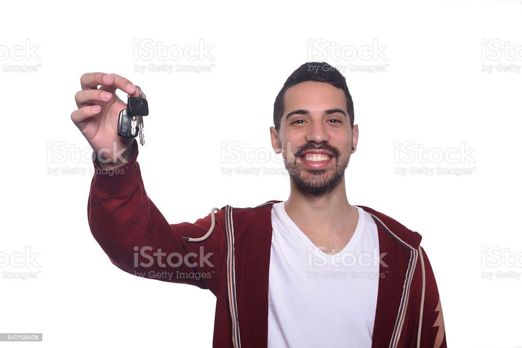 Portrait of young latin man holding car keys. stock photo