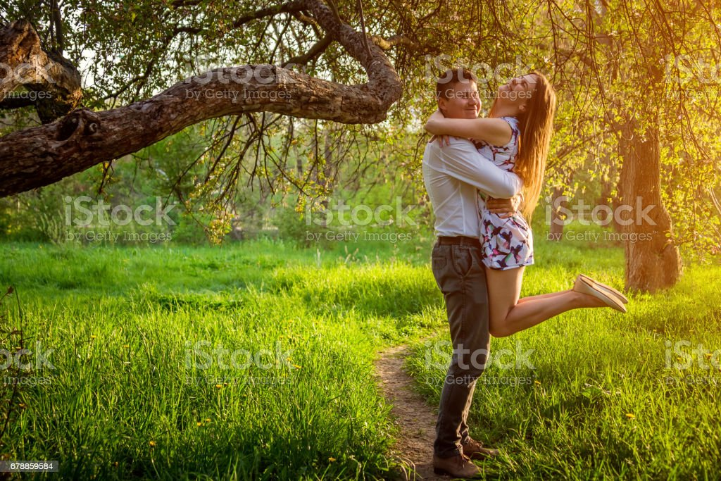 Portrait of young love couple in the garden stock photo