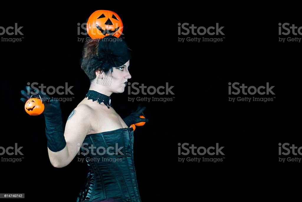 Portrait of young make up woman holding pumpkins stock photo