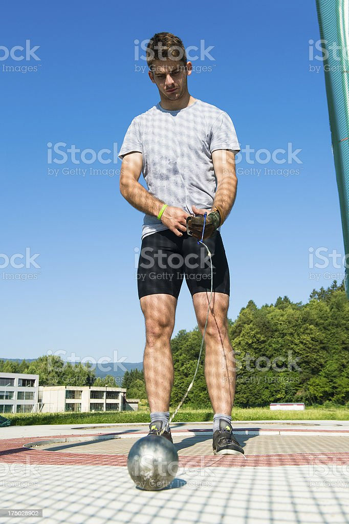 Portrait of young male athlete getting ready for hammer throw stock photo