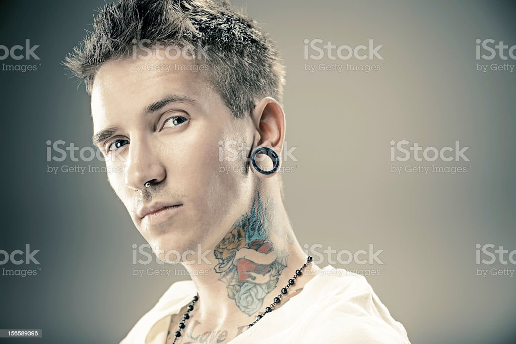 Portrait of young male with tattoos royalty-free stock photo