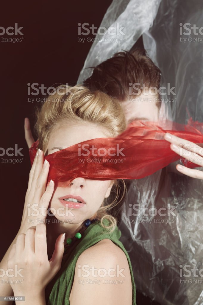 Portrait of young man and woman blindfolded stock photo