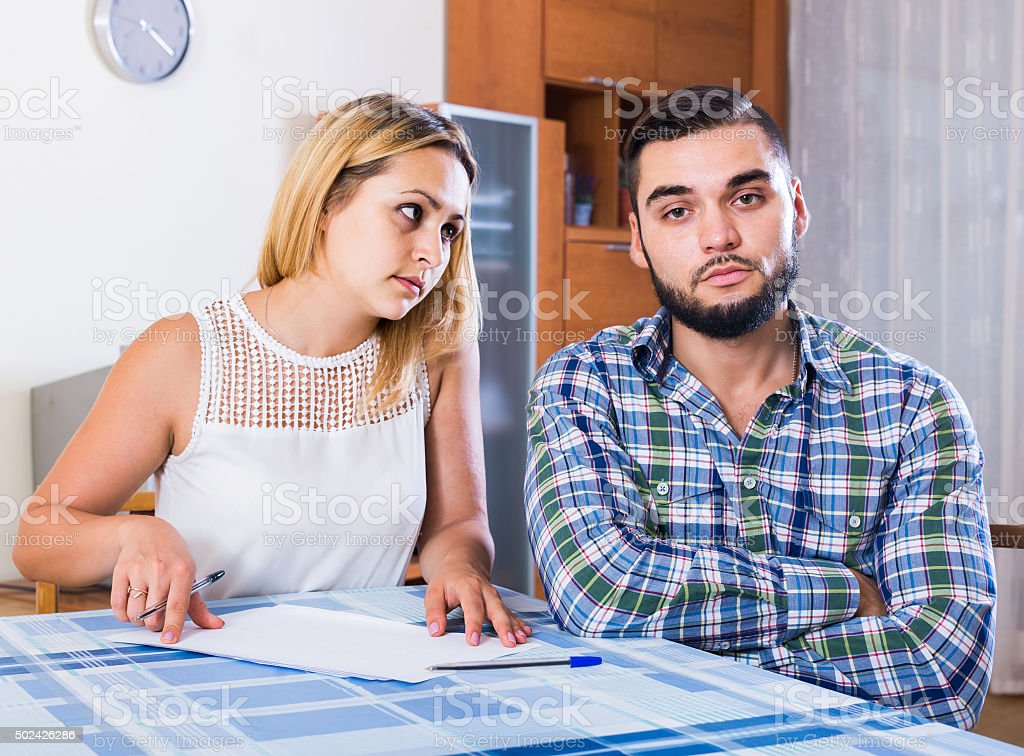 Portrait of young man cannot pay for mortgage stock photo