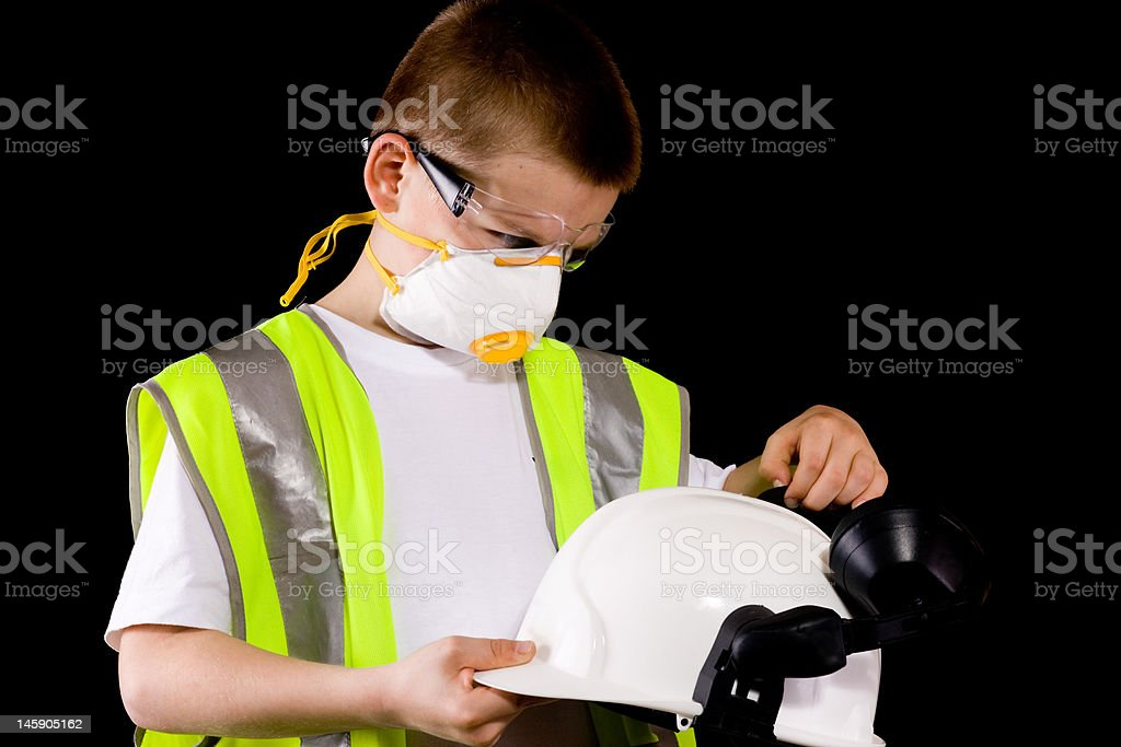 portrait of young man dressed in protective workwear royalty-free stock photo