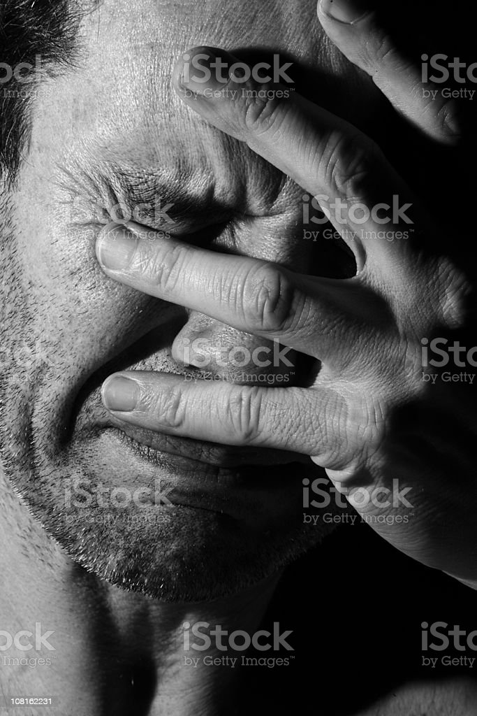 Portrait of Young Man Holding Face and Crying royalty-free stock photo