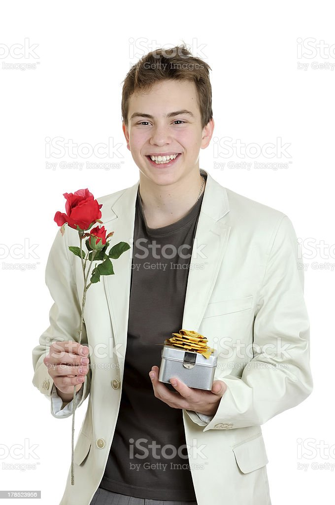 Portrait of young man holding rose and gift royalty-free stock photo