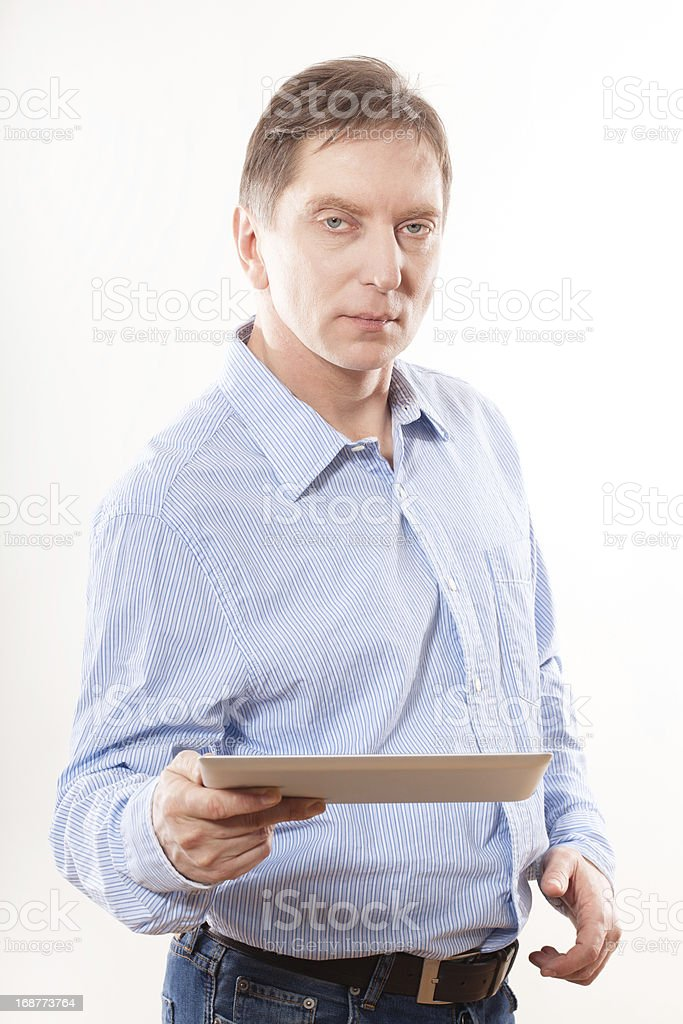 Portrait of young man holding  tablet royalty-free stock photo