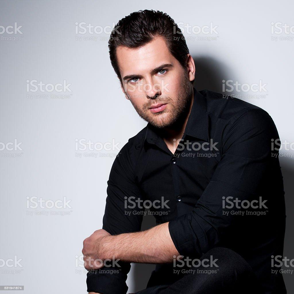 Portrait of young man in black shirt stock photo