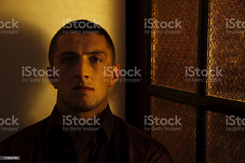Portrait of Young Man in Sidelight stock photo
