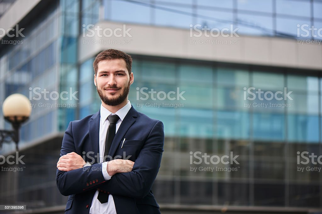 Portrait of young man in suit on stock photo