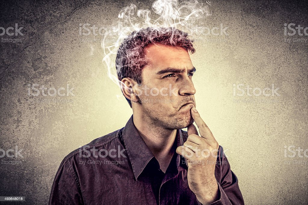 Portrait of Young man intensively thinking. stock photo