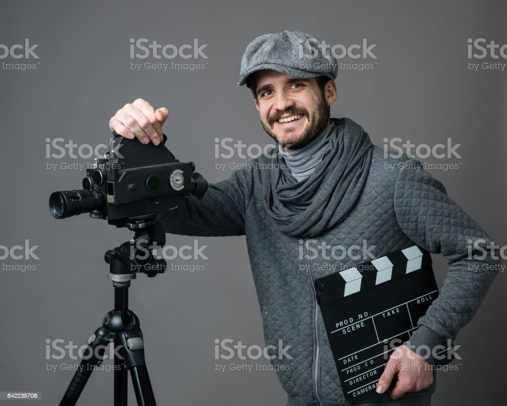 Portrait Of Young Man Leaning On Camera stock photo