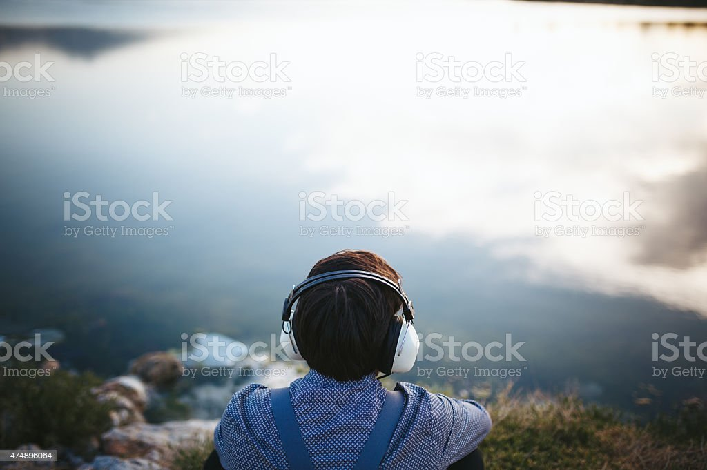 Portrait of young man listen to music stock photo