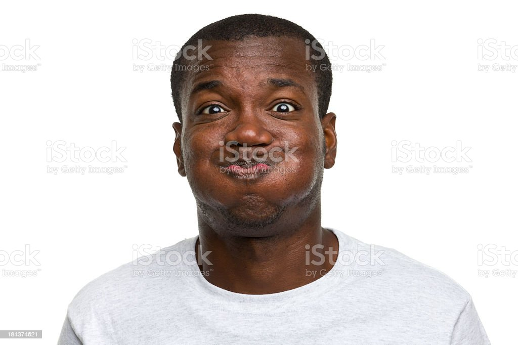 Portrait of young man making a goofy face stock photo