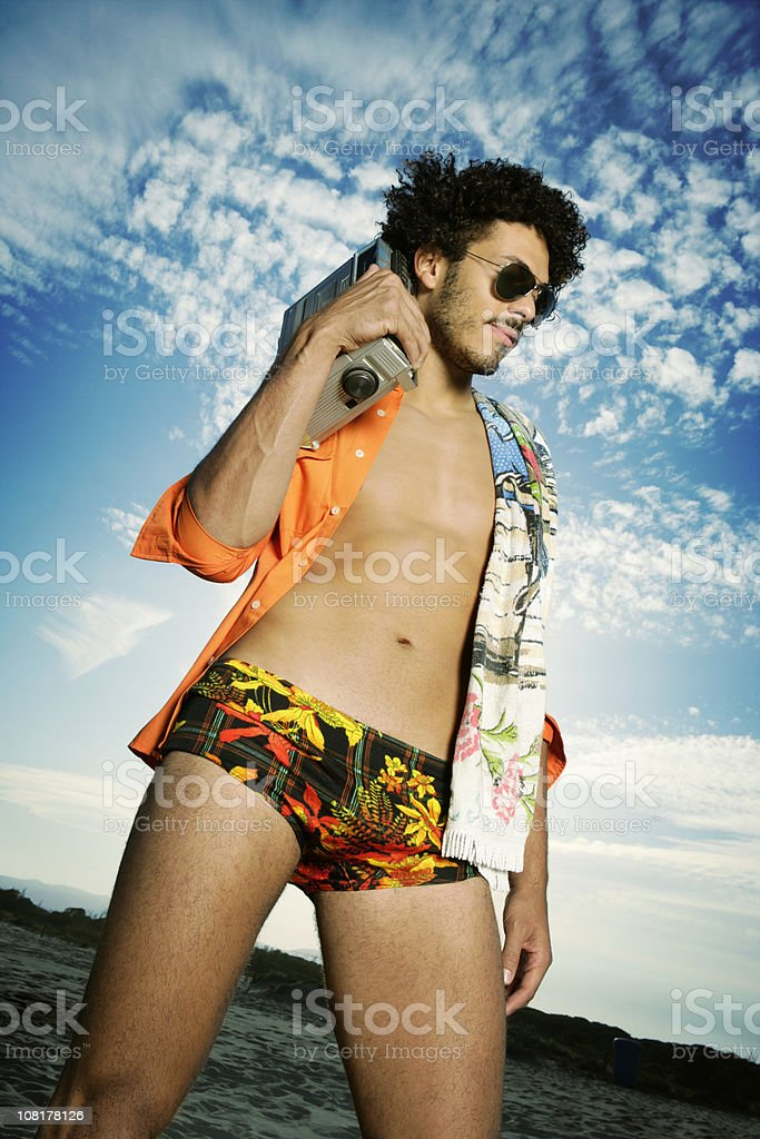 Portrait of Young Man on Beach Wearing Retro Bathing Suit royalty-free stock photo
