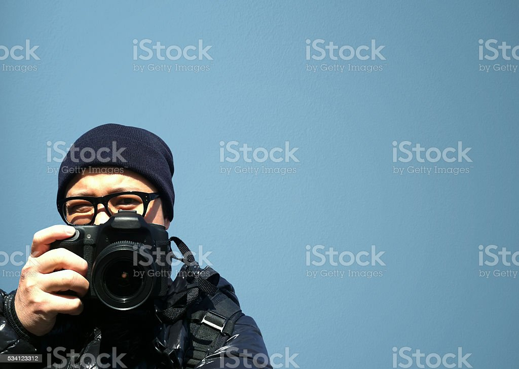 Portrait of young man photographer with camera. paparazzi stock photo