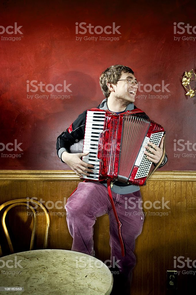 Portrait of Young Man Playing Jazz Accordian stock photo