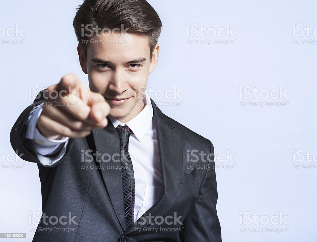 Portrait of young man pointing with his finger stock photo