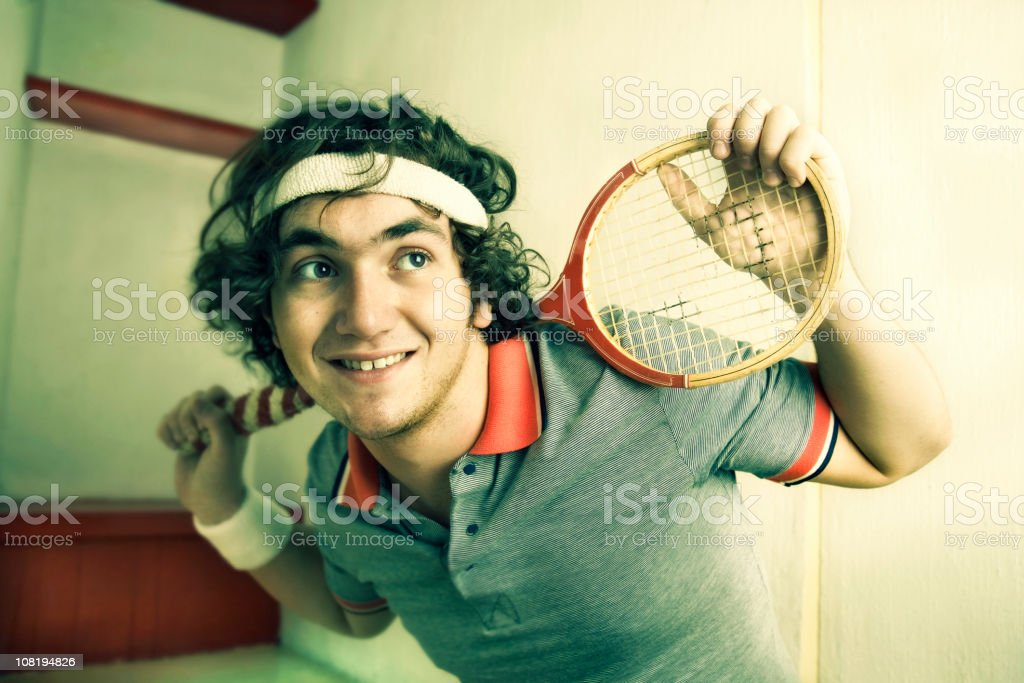 Portrait of Young Man Posing with Racket royalty-free stock photo