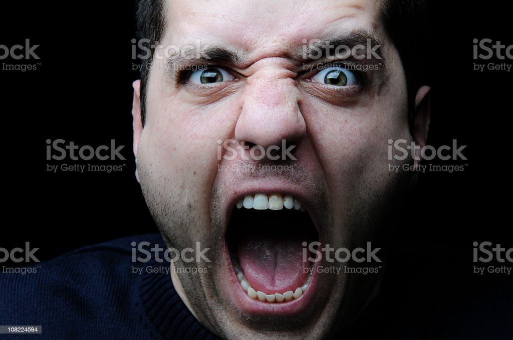 Portrait of Young Man Screaming, On Black Background royalty-free stock photo