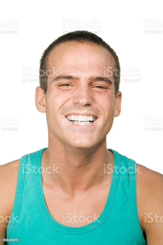 Portrait of young man smiling on white background stock photo