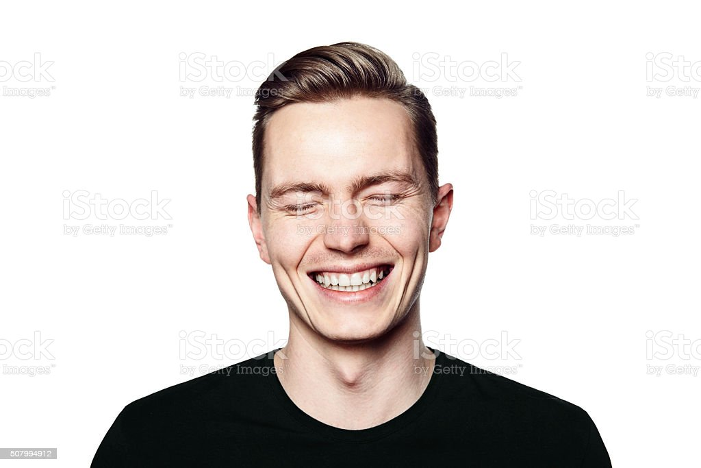 Portrait of young man smiling to camera stock photo