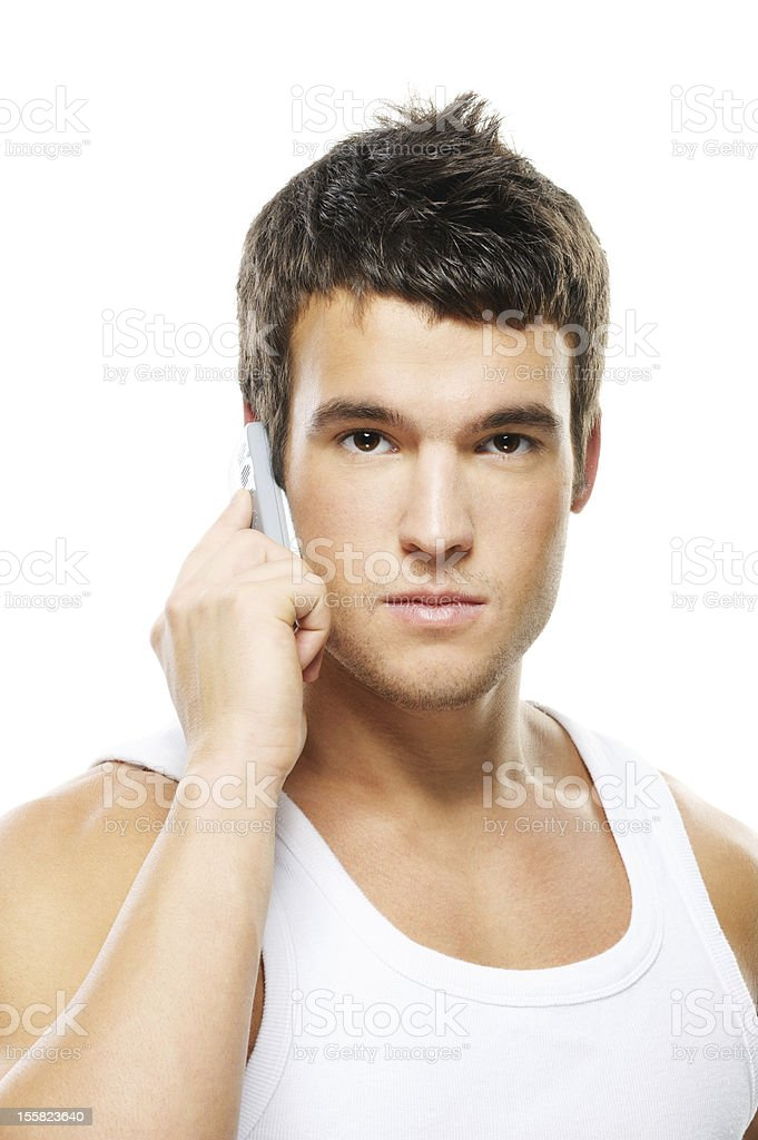 portrait of young man speaking on mobile phone stock photo