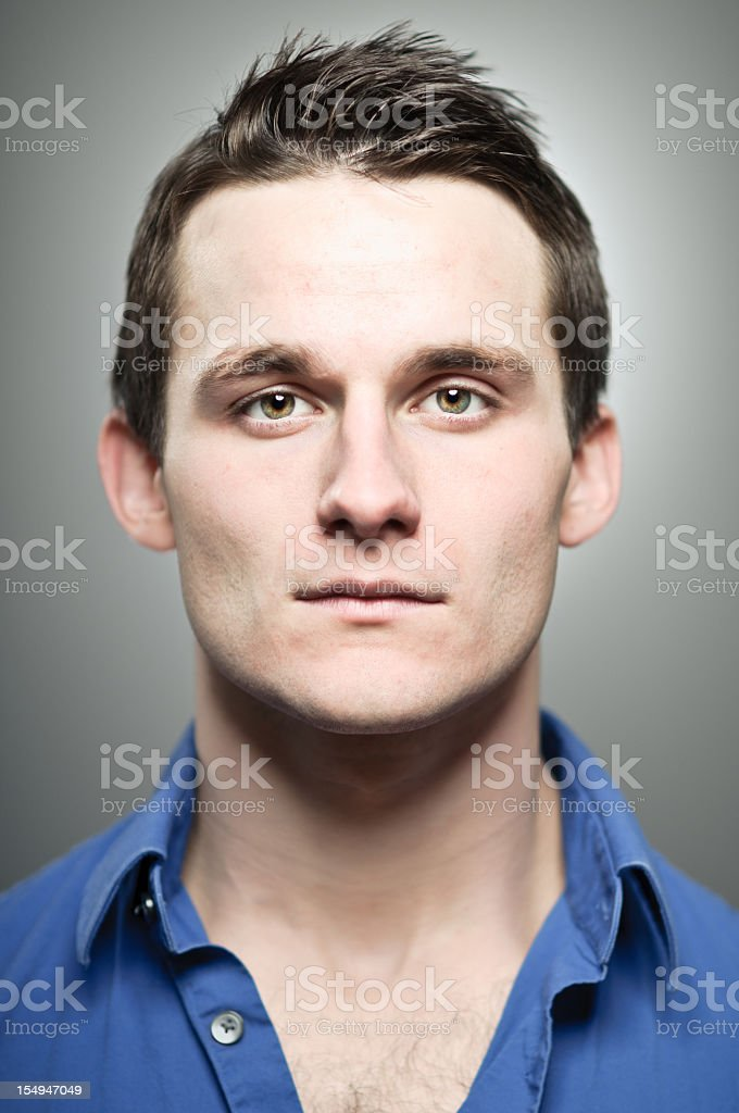 Portrait of young man wearing a blue button up shirt royalty-free stock photo