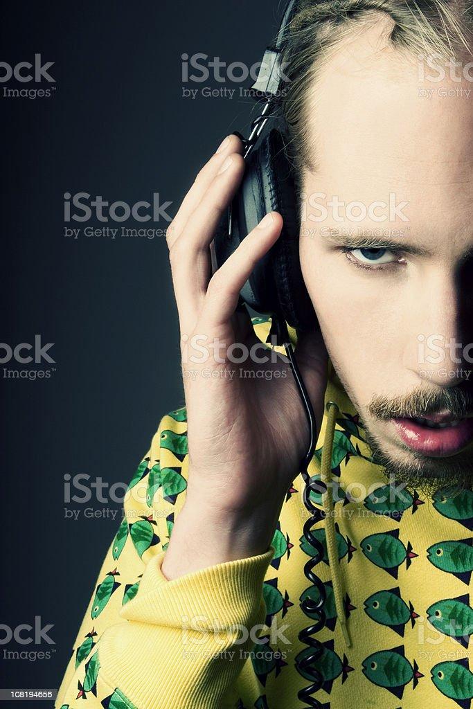 Portrait of Young Man Wearing Headphones stock photo