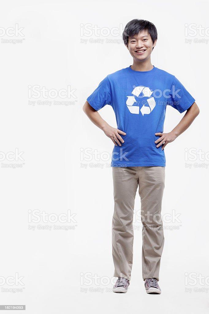 Portrait of young man wearing recycling symbol T-shirt, studio shot royalty-free stock photo