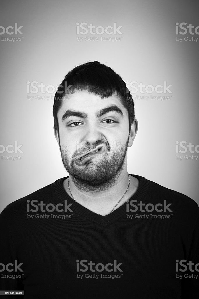 Portrait Of Young Man Who Making A Funny Face stock photo