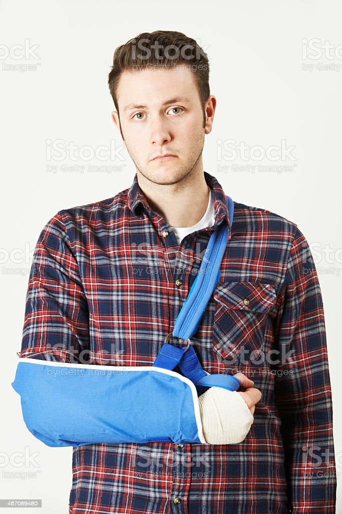 Portrait Of Young Man With Arm In Sling stock photo