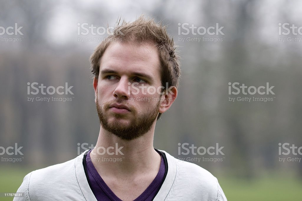 Portrait of young man with beard iwho is unhappy royalty-free stock photo