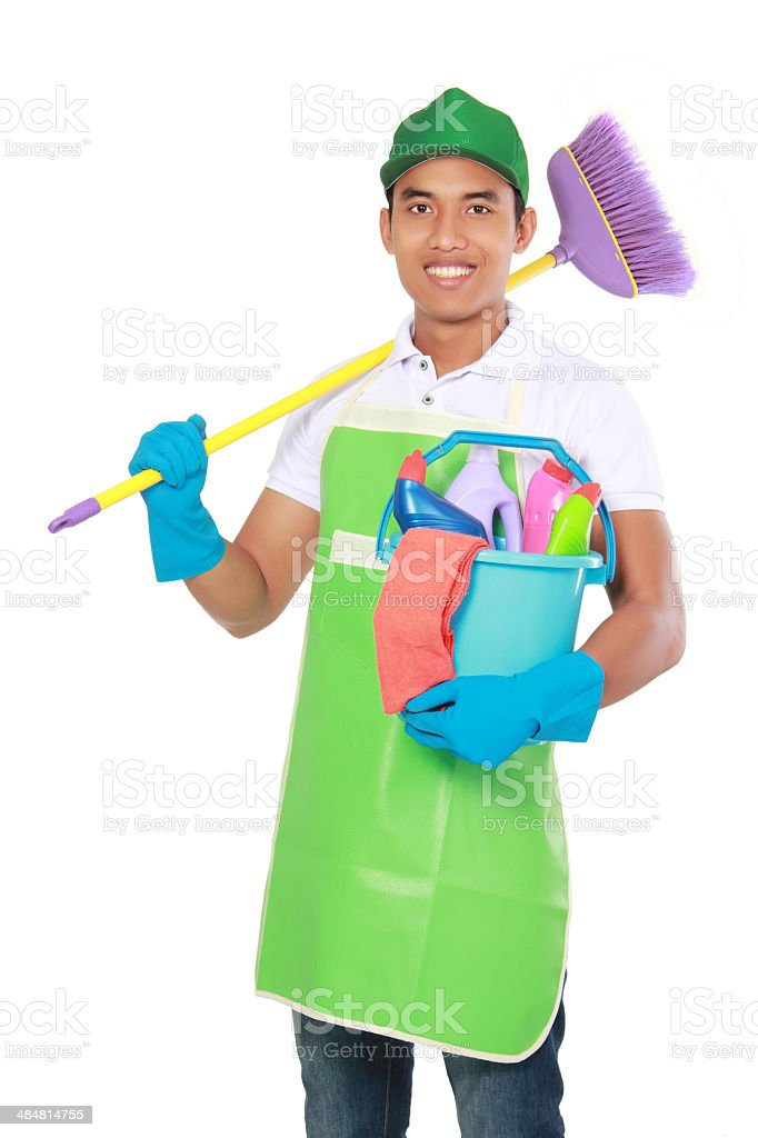 Portrait of young man with cleaning equipment royalty-free stock photo