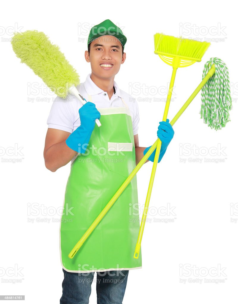 Portrait of young man with cleaning equipment stock photo