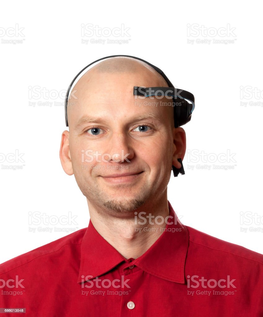 Portrait of young man with EEG headset on head stock photo