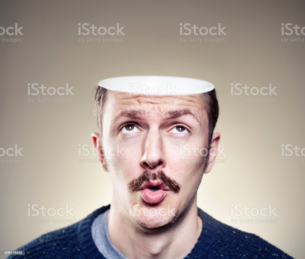 Portrait of young man with empty head stock photo