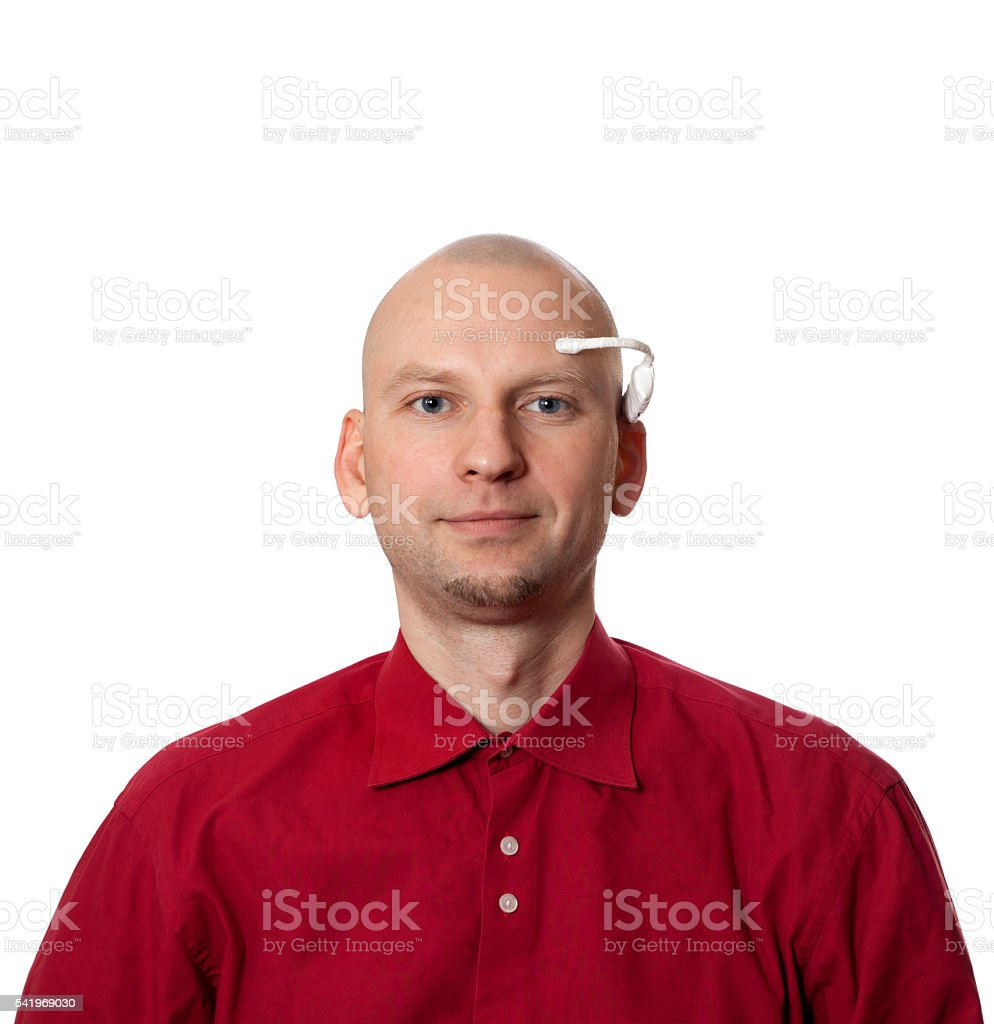 Portrait of young man with handmade EEG headset on head stock photo