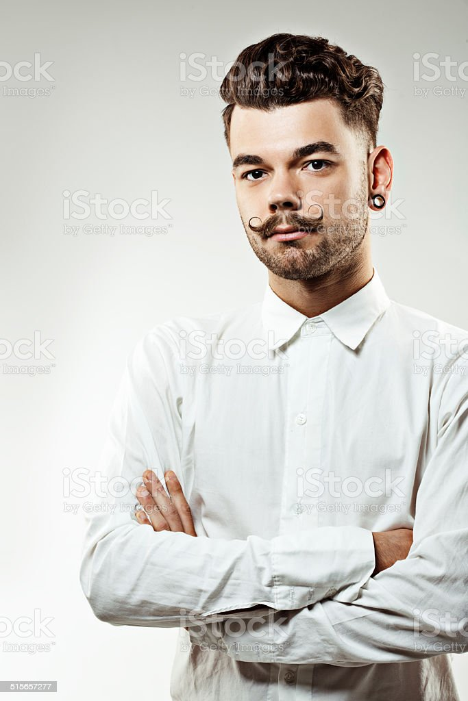 portrait of young man with long moustaches and beard stock photo