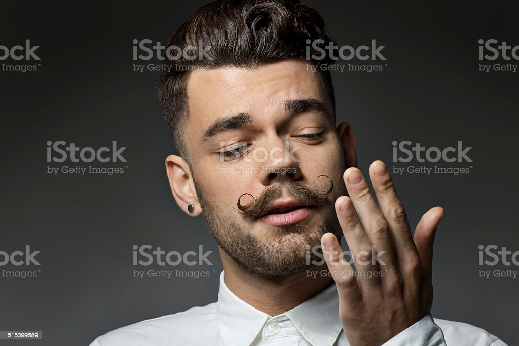 portrait of young man with long moustaches stock photo