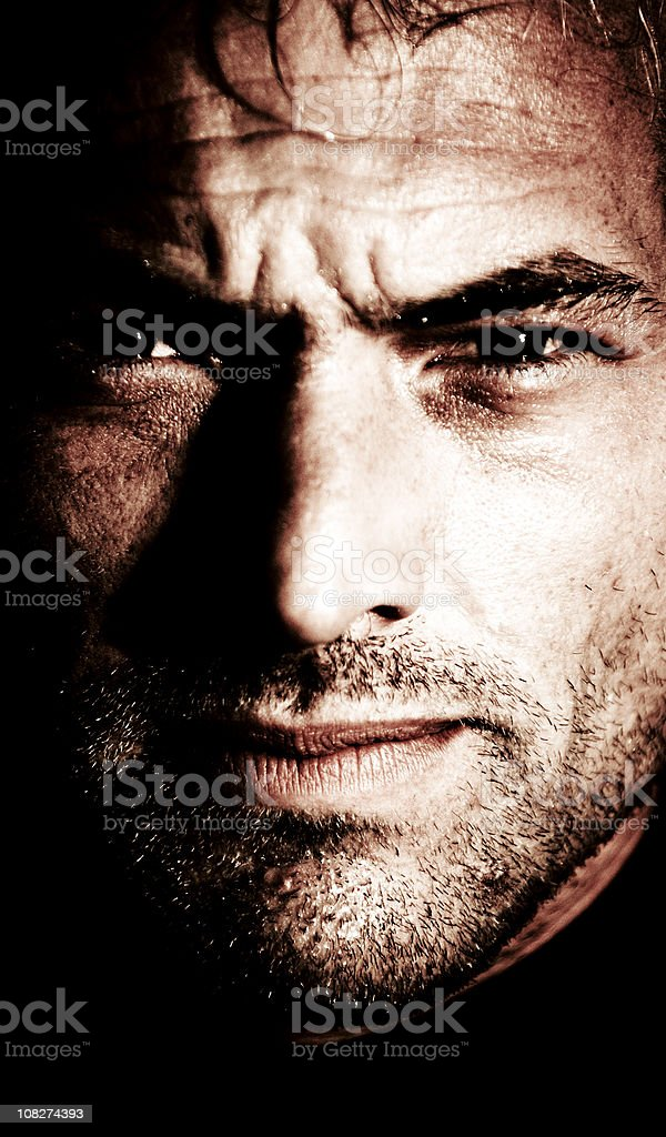 Portrait of Young Man with Serious Expression stock photo