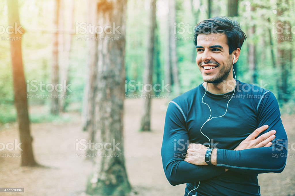 Portrait of young man with sports clothes stock photo