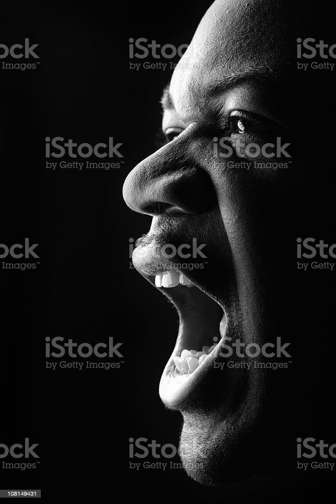 Portrait of Young Man Yelling, Low Key Black and White stock photo